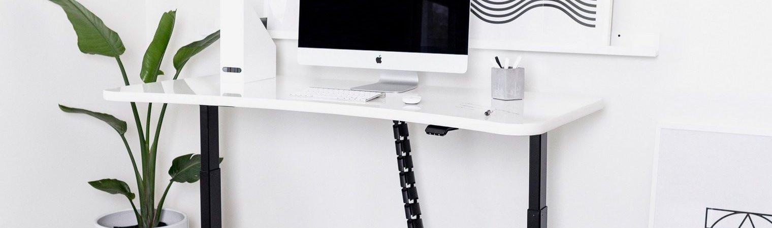 Cable management on height adjustable desks